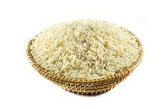 Rice basket. Rice in basket on white background Royalty Free Stock Photo