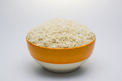 Rice be imperfect in the bowl. Rice be imperfect in the bowl on white background royalty free stock images