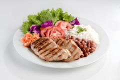 Rice and beans with grilled chicken. Brazilian typical food. Rice, beans, grilled chicken and salad Royalty Free Stock Photos