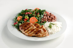 Rice and beans with grilled chicken. Brazilian typical food. Rice, beans, grilled chicken and salad Stock Images