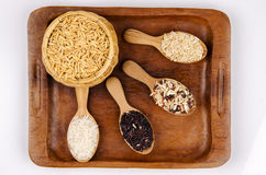 Rice berries, jasmine rice, brown nose, pile of unmilled rice grains, rice, and five species Royalty Free Stock Image