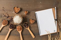 Rice berry, brown and thai red mixed rice with blank notebook Royalty Free Stock Images