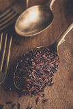 Rice berry on vintage spoon Stock Photo