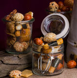 Rice biscuits in jars on wooden and linen background. Rice biscuits in jars of glass on wooden and linen background, closeup Stock Photography