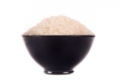 Rice in the black bowl Royalty Free Stock Photography
