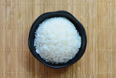 Rice in a black bowl Stock Photo
