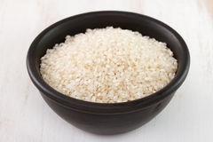 Rice in black bowl Stock Photography