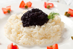Rice with black caviar Royalty Free Stock Image