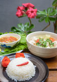 Rice on black dish and meat soup with Royalty Free Stock Photo