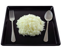 Rice in black plate. Royalty Free Stock Photos