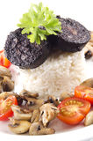 Rice with black pudding on a plate Royalty Free Stock Images