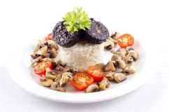 Rice with black pudding on a plate Royalty Free Stock Photo
