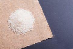 Rice  on black stone table with khaki linen Stock Image