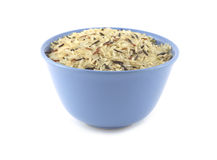 Rice in blue bowl isolated Royalty Free Stock Photos