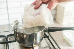 Rice and boiling water Royalty Free Stock Image