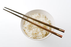 Rice bowl. Plain rice bowl with chopsticks from above isolated on on white Stock Photos