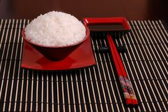Rice bowl with chop sticks. Rice in black and red bowl with chop sticks Stock Photography
