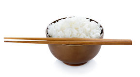 Rice in bowl and chopsticks on white background Royalty Free Stock Photos