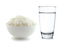Rice in a bowl and Glass of water on white background Royalty Free Stock Image