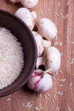 Rice in bowl with mushrooms Stock Photo