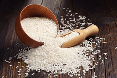 Rice in bowl and scattered near Royalty Free Stock Image