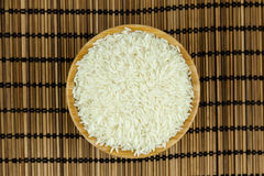 Rice in the Bowl on Traditional Asian Plate Mat.  Royalty Free Stock Photography