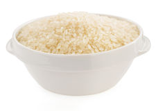 Rice in bowl. On white background Royalty Free Stock Photography