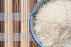 Rice bowl on wooden mat Royalty Free Stock Photography