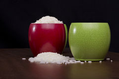 Rice in bowls. Rice beans spilled in colorful bowls Stock Images