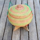 Rice box made from bamboo and nylon on old wooden. Royalty Free Stock Images