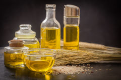 Rice bran oil. In bottle glass with seed Royalty Free Stock Photo