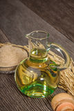 Rice bran oil. In bottle glass with seed and bran on the old plank wood Royalty Free Stock Images