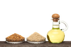 Rice bran oil. In bottle glass with seed and bran on the old plank wood Stock Images