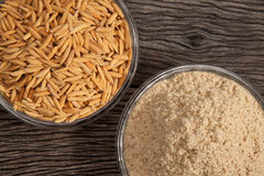 Rice bran and Paddy. In dish on the old plank wood Royalty Free Stock Images