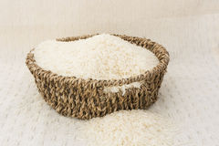 Rice in a brown basket. A swamp grass that is widely cultivated as a source of food, esp. in Asia royalty free stock images