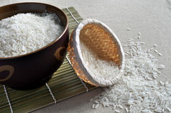 Rice in brown bowl and basket. Rice contained in a brown bowl and a small basket Royalty Free Stock Photos