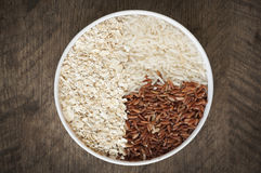 Rice. Brown rice and white rice in cup have wood table is backgruond Royalty Free Stock Photos
