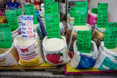 Rice in Bulk. Bangkok/Thailand - January 4, 2015: Khlong Toei Market in Bangkok Thailand on a busy day with grains and rice for sale in bulk royalty free stock image