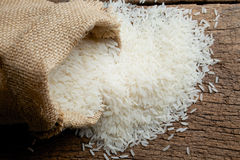 Rice in burlap sack Stock Photo