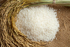 Rice in burlap sack Stock Photo