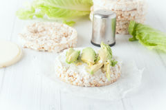 Rice cake with cream cheese and avocado Stock Photo