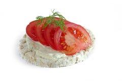 Rice cake with tomatoes isolatetd on white background Royalty Free Stock Photos