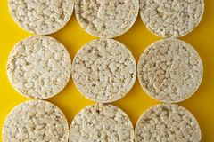 Rice cakes background, over yellow background. Top view. Food background. Dietary rice bread stock image