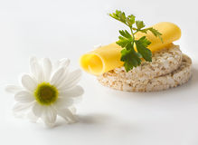 Rice cakes with cheese, parsley and chamomile flowers Stock Image