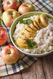 Rice with caramelized apples and mint in a bowl close up. vertic Royalty Free Stock Photo