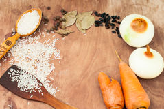 Rice, carrot, onion, spices, barberry on a table set for pilaf Royalty Free Stock Images