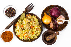 Rice with carrots, chicken and spices Stock Image
