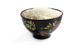 Rice in ceramic ware. Isolated on the white Stock Photos