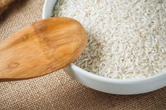 Rice cereal and wooden spoon on burlap background Stock Image
