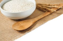 Rice cereal and wooden spoon on burlap background Royalty Free Stock Images